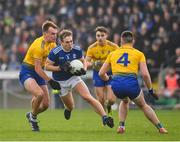 24 February 2019; Padraig Faulkner of Cavan in action against Enda Smith, left, and Evan McGrath of Roscommon during the Allianz Football League Division 1 Round 4 match between Cavan and Roscommon at the Kingspan Breffni Park in Cavan. Photo by Seb Daly/Sportsfile