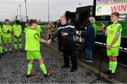 24 February 2019; Paddy Dempsey, DDSL Chairman, presents the winners medals to the DDSL players following the U15 SFAI SUBWAY Championship Final match between DDSL and Waterford SL at Mullingar Athletic FC in Gainestown, Mullingar, Co. Westmeath. Photo by Sam Barnes/Sportsfile