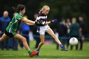 19 August 2018; Caoimhe Flannery of Skibereen, Co. Cork, in action against Zara Byrne of Ashbourne, Co. Meath, as they compete in the Gaelic Football Girls U12 event during day two of the Aldi Community Games August Festival at the University of Limerick in Limerick. Photo by Harry Murphy/Sportsfile