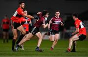 20 February 2019; Jarlath Óg Burns of St Mary's in action against Padraig Lucey, left, and Daniel O'Brien of UCC during the Electric Ireland HE GAA Sigerson Cup Final match between St Mary's University College Belfast and University College Cork at O'Moore Park in Portlaoise, Laois. Photo by Piaras Ó Mídheach/Sportsfile