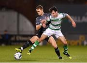 1 March 2019; Dane Massey of Dundalk in action against Joel Coustrain of Shamrock Rovers during the SSE Airtricity League Premier Division match between Shamrock Rovers and Dundalk at Tallaght Stadium in Dublin. Photo by Seb Daly/Sportsfile