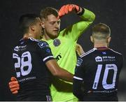 1 March 2019; James Talbot of Bohemians is embraced by team-mates Ali Reghba, left, and Keith Ward during the SSE Airtricity League Premier Division match between Waterford and Bohemians at the RSC in Waterford. Photo by Harry Murphy/Sportsfile