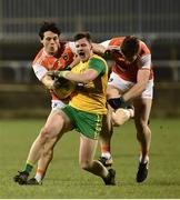 2 March 2019; Jamie Brennan of Donegal  in action against James Morgan, left, and Charlie Vernon of Armagh  during the Allianz Football League Division 2 Round 5 match between Donegal and Armagh at MacCumhail Park in Ballybofey, Donegal. Photo by Oliver McVeigh/Sportsfile