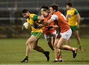 2 March 2019; Jamie Brennan of Donegal  in action against James Morgan and Charlie Vernon of Armagh  during the Allianz Football League Division 2 Round 5 match between Donegal and Armagh at MacCumhail Park in Ballybofey, Donegal. Photo by Oliver McVeigh/Sportsfile