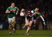 2 March 2019; Ciarán Duggan of Galway in action against Donal Vaughan, left, and Keith Higgins of Mayo during the Allianz Football League Division 1 Round 5 match between Mayo and Galway at Elverys MacHale Park in Castlebar, Mayo. Photo by Piaras Ó Mídheach/Sportsfile