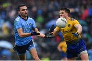 3 March 2019; Niall Scully of Dublin in action against Ronan Daly of Roscommon during the Allianz Football League Division 1 Round 5 match between Roscommon and Dublin at Dr Hyde Park in Roscommon. Photo by Ramsey Cardy/Sportsfile