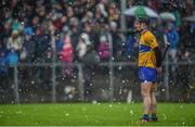 3 March 2019; Ian Galvin of Clare tries to keep his hurley dry during the Allianz Hurling League Division 1A Round 5 match between Clare and Limerick at Cusack Park in Ennis, Co. Clare. Photo by Diarmuid Greene/Sportsfile