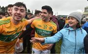 3 March 2019; Leitrim players Dean McGovern and Emlyn Mulligan celebrate amongst fans after the Allianz Football League Division 4 Round 5 match between Leitrim and London at Avantcard Páirc Seán Mac Diarmada in Carrick-on-Shannon, Co. Leitrim. Photo by Oliver McVeigh/Sportsfile