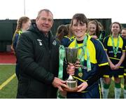 4 March 2019; Kate McClenaghan of Moville CC is presented the trophy by FAI School's Executive Nixon Morton following the FAI Schools Senior Girls National Cup Final match between Athlone Community College and Moville Community College at the Showgrounds in Sligo. Photo by Harry Murphy/Sportsfile