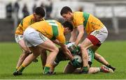 3 March 2019; Conor O'Neill of Londonis surrounded by Mark Plunkett, Domhnaill Flynn and Aidan Flynn of Leitrim during the Allianz Football League Division 4 Round 5 match between Leitrim and London at Avantcard Páirc Seán Mac Diarmada in Carrick-on-Shannon, Co. Leitrim. Photo by Oliver McVeigh/Sportsfile