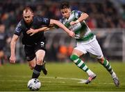 1 March 2019; Chris Shields of Dundalk in action against Ronan Finn of Shamrock Rovers during the SSE Airtricity League Premier Division match between Shamrock Rovers and Dundalk at Tallaght Stadium in Dublin. Photo by Seb Daly/Sportsfile