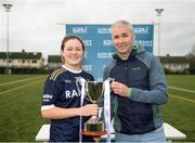 8 March 2019; Nicole Catney of Ulster University is presented the trophy by Chairperson of HEC Donal Barry following the Gourmet Food Parlour Lagan Cup Final match between Ulster University and Dublin City University at TU Dublin Broombridge Sports Grounds in Dublin. Photo by Harry Murphy/Sportsfile