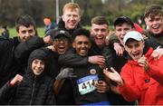 9 March 2019; Efron Giddey of Le Chéile Tyrrelstown, Dublin, celebrates with supporters after winning the Senior Boys event at the Irish Life Health All Ireland Schools Cross Country at Clongowes Wood College in Clane, Co Kildare. Photo by Piaras Ó Mídheach/Sportsfile