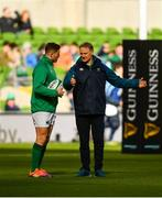 10 March 2019; Ireland head coach Joe Schmidt in conversation with Jordan Larmour prior to the Guinness Six Nations Rugby Championship match between Ireland and France at the Aviva Stadium in Dublin. Photo by Ramsey Cardy/Sportsfile