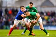 10 March 2019; John Cooney of Ireland is tackled by Antoine Dupont of France during the Guinness Six Nations Rugby Championship match between Ireland and France at the Aviva Stadium in Dublin. Photo by Ramsey Cardy/Sportsfile