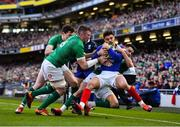 10 March 2019; Romain Ntamack of France is tackled by Ireland players Jacob Stockdale, Peter O'Mahony and Conor Murray during the Guinness Six Nations Rugby Championship match between Ireland and France at the Aviva Stadium in Dublin. Photo by Brendan Moran/Sportsfile