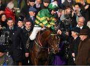 12 March 2019; Jockey Mark Walsh is congratulated by owner JP McManus after winning the Unibet Champion Hurdle Challenge Trophy on Espoir D'Allen on Day One of the Cheltenham Racing Festival at Prestbury Park in Cheltenham, England. Photo by Seb Daly/Sportsfile