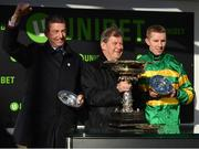 12 March 2019; Winning trainer Gavin Cromwell, left, owner JP McManus, centre, and jockey Mark Walsh after sending out Espoir D'Allen to win the Unibet Champion Hurdle Challenge Trophy on Day One of the Cheltenham Racing Festival at Prestbury Park in Cheltenham, England. Photo by Seb Daly/Sportsfile