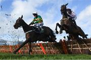 12 March 2019; Buveur D'air, with Barry Geraghty, up, left, jump the last next to Sharjah, with Patrick Mullins up, during the Unibet Champion Hurdle Challenge Trophy on Day One of the Cheltenham Racing Festival at Prestbury Park in Cheltenham, England. Photo by David Fitzgerald/Sportsfile