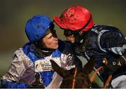 12 March 2019; Jockey Harry Skelton, left, is congratulated by Paddy Brennan, right, after winning the OLBG Mares' Hurdle on Roksana on Day One of the Cheltenham Racing Festival at Prestbury Park in Cheltenham, England. Photo by Seb Daly/Sportsfile