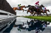 13 March 2019; Topofthegame, with Harry Cobden up, left, clears the water jump on their way to winning the RSA Insurance Novices' Chase on Day Two of the Cheltenham Racing Festival at Prestbury Park in Cheltenham, England. Photo by David Fitzgerald/Sportsfile