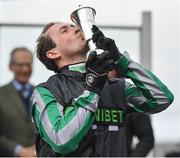 13 March 2019; Jockey Nico de Boinville kisses the trophy after winning the Betway Queen Mother Champion Chase on Altior on Day Two of the Cheltenham Racing Festival at Prestbury Park in Cheltenham, England. Photo by Seb Daly/Sportsfile