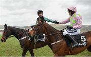 13 March 2019; Nico de Boinville on Altior is congratulated by Ruby Walsh after winning the Betway Queen Mother Champion Chase on Day Two of the Cheltenham Racing Festival at Prestbury Park in Cheltenham, England. Photo by David Fitzgerald/Sportsfile
