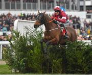 13 March 2019; Tiger Roll, with Keith Donoghue up, jumps the last on their way to winning the Glenfarclas Cross Country Chase on Day Two of the Cheltenham Racing Festival at Prestbury Park in Cheltenham, England. Photo by Seb Daly/Sportsfile