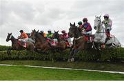 13 March 2019; A view of the field, including eventual winner Tiger Roll, centre, with Keith Donoghue up, jump the first during the Glenfarclas Cross Country Chase on Day Two of the Cheltenham Racing Festival at Prestbury Park in Cheltenham, England. Photo by Seb Daly/Sportsfile