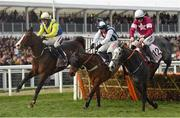 13 March 2019; Band Of Outlaws, left, with JJ Slevin up, jumps the last, alongside eventual second place Coko Beach, right, with Jack Kennedy up, and eventual sixth place Praeceps, with Wayne Hutchinson up, on their way to winning the Boodles Juvenile Handicap Hurdle on Day Two of the Cheltenham Racing Festival at Prestbury Park in Cheltenham, England. Photo by Seb Daly/Sportsfile