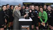 13 March 2019; Emma Yourell, Marketing Executive of Rustlers Ireland, presenting the Kelly Cup to Ciara McNamara of University College Cork after the WSCAI Kelly Cup Final match between University College Cork and Maynooth University at Seaview in Belfast. Photo by Oliver McVeigh/Sportsfile