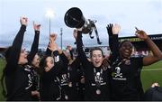 13 March 2019; Ciara McNamara of University College Cork and her teammates celebrate with the Kelly Cup after the WSCAI Kelly Cup Final match between University College Cork and Maynooth University at Seaview in Belfast. Photo by Oliver McVeigh/Sportsfile