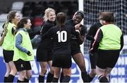 13 March 2019; Vanessa Ogbonna of University College Cork receives the congratulations from her team-mates after scoring the decisive penalty during the penalty shoot out in the WSCAI Kelly Cup Final match between University College Cork and Maynooth University at Seaview in Belfast. Photo by Oliver McVeigh/Sportsfile