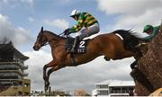 14 March 2019; Defi Du Seuil, with Barry Geraghty up, jumps the last jump the last first time round on their way to winning the JLT Novices' Chase on Day Three of the Cheltenham Racing Festival at Prestbury Park in Cheltenham, England. Photo by David Fitzgerald/Sportsfile