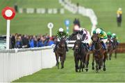 14 March 2019; Sire Du Berlais, right, with Barry Geraghty up, races alongside eventual third place Not Many Left, with Mark Walsh up, on their way to winning the Pertemps Network Final Handicap Hurdle on Day Three of the Cheltenham Racing Festival at Prestbury Park in Cheltenham, England. Photo by Seb Daly/Sportsfile