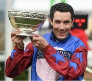 14 March 2019; Aidan Coleman celebrates with the cup after riding Paisley Park to win the Sun Racing Stayers' Hurdle on Day Three of the Cheltenham Racing Festival at Prestbury Park in Cheltenham, England. Photo by David Fitzgerald/Sportsfile