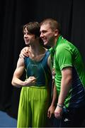 15 March 2019; Team Ireland's John Keenan, a member of the St.Hilda's Special School, from Ballymore, Co. Westmeath, poses for a photographer with his coach Anthony Monaghan, right, after his the pommel horse routine during the Artistic Gymnastic events on Day One of the 2019 Special Olympics World Games in the Abu Dhabi National Exhibition Centre, Abu Dhabi, United Arab Emirates. Photo by Ray McManus/Sportsfile