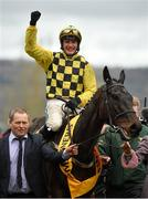 15 March 2019; Jockey Paul Townend celebrates as he enters the winners enclosure after winning the Magners Cheltenham Gold Cup Chase on al Boum Photo on Day Four of the Cheltenham Racing Festival at Prestbury Park in Cheltenham, England. Photo by Seb Daly/Sportsfile