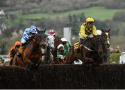 15 March 2019; Al Boum Photo, right, with Paul Townend up, jumps the last, alongside Double Shuffle, with Jonathan Burke up, during the first circuit on their way to winning the Magners Cheltenham Gold Cup Chase on Day Four of the Cheltenham Racing Festival at Prestbury Park in Cheltenham, England. Photo by Seb Daly/Sportsfile