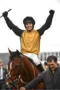 15 March 2019; Jockey Kielan Woods celebrates as he enters the winners enclosure after winning the Johnny Henderson Grand Annual Challenge Cup Handicap Chase on Croco Bay on Day Four of the Cheltenham Racing Festival at Prestbury Park in Cheltenham, England. Photo by Seb Daly/Sportsfile