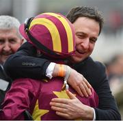 15 March 2019; Trainer Henry de Bromhead hugs Jockey Rachael Blackmore after winning the Albert Bartlett Novices' Hurdle with Minella Indo on Day Four of the Cheltenham Racing Festival at Prestbury Park in Cheltenham, England. Photo by Seb Daly/Sportsfile