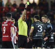 15 March 2019; Referee Ben Connolly issues a yellow card to Brian Gartland of Dundalk during the SSE Airtricity League Premier Division match between Derry City and Dundalk at Ryan McBride Brandywell Stadium in Derry Photo by Oliver McVeigh/Sportsfile