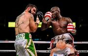 15 March 2019; Jono Carroll, left, and Tevin Farmer during their International Boxing Federation World Super Featherweight title bout at the Liacouras Center in Philadelphia, USA. Photo by Stephen McCarthy / Sportsfile