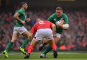 16 March 2019; Tadhg Furlong of Ireland is tackled by Ken Owens of Wales during the Guinness Six Nations Rugby Championship match between Wales and Ireland at the Principality Stadium in Cardiff, Wales. Photo by Ramsey Cardy/Sportsfile