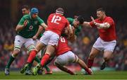 16 March 2019; James Ryan of Ireland is tackled by Hadleigh Parkes, left, and Ross Moriarty of Wales during the Guinness Six Nations Rugby Championship match between Wales and Ireland at the Principality Stadium in Cardiff, Wales. Photo by Ramsey Cardy/Sportsfile