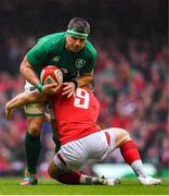 16 March 2019; CJ Stander of Ireland is tackled by Gareth Davies of Wales during the Guinness Six Nations Rugby Championship match between Wales and Ireland at the Principality Stadium in Cardiff, Wales. Photo by Brendan Moran/Sportsfile