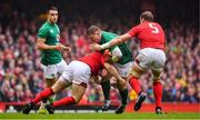 16 March 2019; Tadhg Furlong of Ireland is tackled by Ken Owens and Alun Wyn Jones of Wales during the Guinness Six Nations Rugby Championship match between Wales and Ireland at the Principality Stadium in Cardiff, Wales. Photo by Brendan Moran/Sportsfile