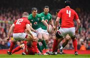 16 March 2019; Jonathan Sexton of Ireland passes to team-mate Bundee Aki during the Guinness Six Nations Rugby Championship match between Wales and Ireland at the Principality Stadium in Cardiff, Wales. Photo by Brendan Moran/Sportsfile