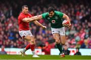 16 March 2019; Jacob Stockdale of Ireland is tackled by Gareth Davies of Wales during the Guinness Six Nations Rugby Championship match between Wales and Ireland at the Principality Stadium in Cardiff, Wales. Photo by Brendan Moran/Sportsfile
