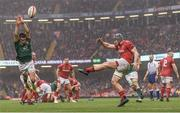 16 March 2019; Jonathan Davies of Wales under pressure from Conor Murray of Ireland during the Guinness Six Nations Rugby Championship match between Wales and Ireland at the Principality Stadium in Cardiff, Wales. Photo by Ramsey Cardy/Sportsfile